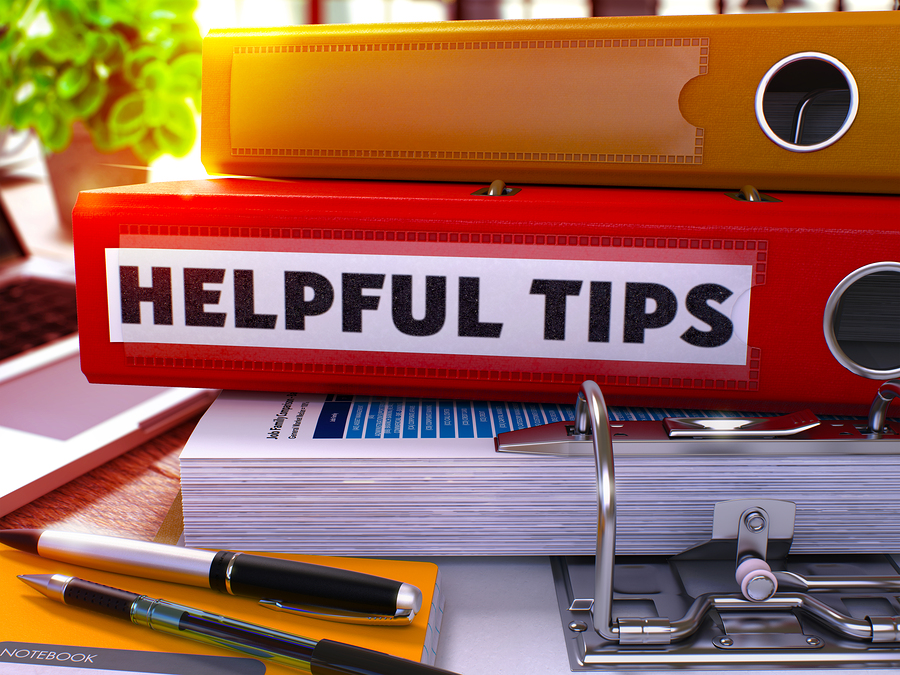 Red Office Folder with Inscription Helpful Tips.